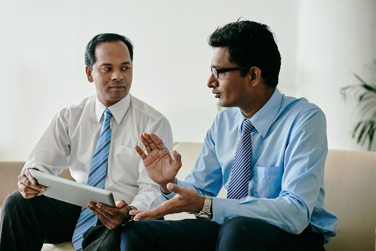 Indians discussing how to register a company in Singapore